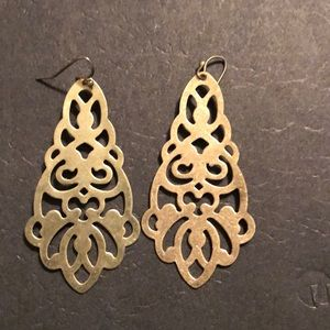 Worn gold earrings